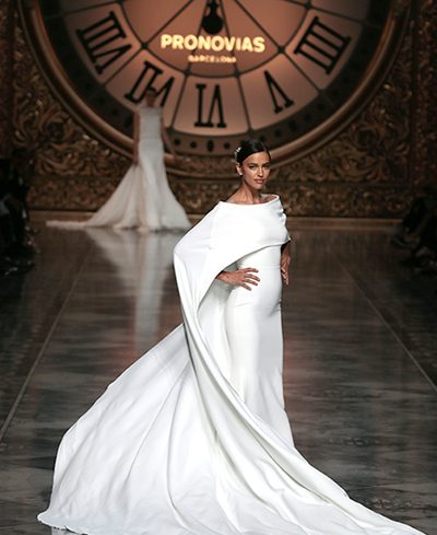 Barcelona Bridal Week 2016 Irina Shayk modelling wedding gown with cape